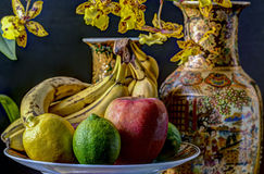 Fruit and orchid still life Stock Photography