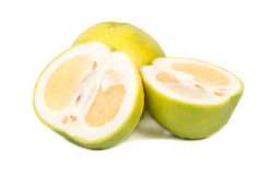 Fruit oroblanco with halves Royalty Free Stock Images