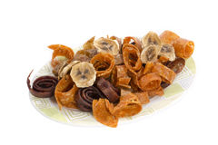Fruit pastille and dried bananas on a plate. On a white background Stock Photo
