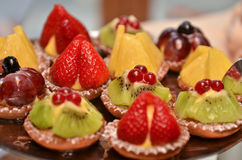 Fruit pastries. A plate with fruit pastries- close up royalty free stock photography