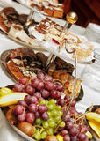 Fruit and Pastries on Banquet Table. Wedding or banquet table set with assorted fruit and desserts stock photos