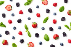 Fruit pattern of colorful berries and mint leaves royalty free stock images