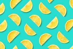 Fruit pattern of lemon slices. Colorful fruit pattern of lemon slices on blue background. Top view. Flat lay stock photo