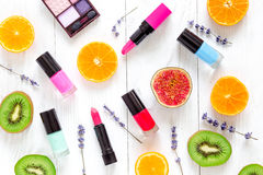 Fruit pattern with lipstick and nailpolish on white desk background top view Royalty Free Stock Photo