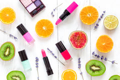 Fruit pattern with lipstick and nailpolish on white desk background top view Stock Images