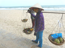 The fruit peddler on the beach in Phan Thiet Stock Photo