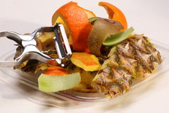 Fruit peels and peeler Stock Photos