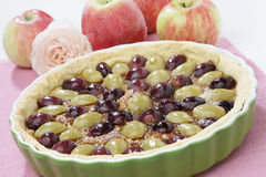 Fruit pie. With grapes and apples royalty free stock images