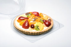 Fruit pie. A fruit pie in a plastic transparent box Royalty Free Stock Images