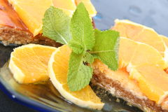 Fruit pie. Sweet pie with orange and spearmint Royalty Free Stock Photography