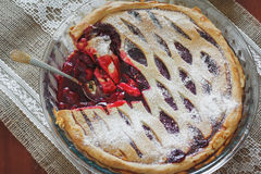 Fruit pie with cherries. Eating the fruit pie with cherries royalty free stock image