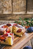 Fruit pie with fresh plums, autumn dessert stock images