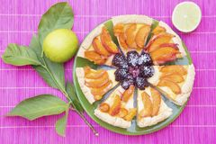 Fruit pie. On a green plate stock image