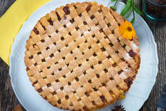 Fruit pie. On natural wood table stock photography