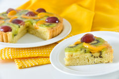 Fruit pie piece. Fruit tart cake on a plate, yellow tablecloth background Stock Image