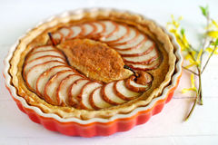 Fruit pie with piers and almond meal in a dish Stock Image