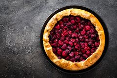 Fruit pie. Sweet pie, tart with fresh cherry. Delicious cake with cherry. Top view stock image