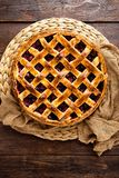 Fruit pie. Sweet pie, tart with fresh plums. Delicious cake with plums. Top view royalty free stock photos