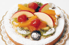 Fruit pie, tart. Fruit pie, colorful tart with fresh fruit, icing sugar and jelly. Photographed over white royalty free stock image