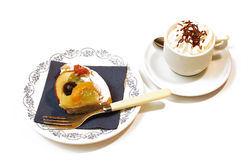 Fruit pie, tart. Fruit pie, colorful tart with fresh fruit, icing sugar and jelly and a cup of coffee with cream, over white stock photography