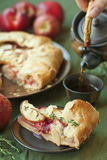 Fruit pie and tea. Homemade summer fruit pie with almond and thyme Royalty Free Stock Image