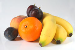 Fruit-piece. Fruit isolated. Bananas, Orange, Peach, Plum Stock Photography