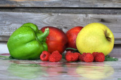 Fruit-piece. Pepper, peaches, apple and raspberries Royalty Free Stock Photos