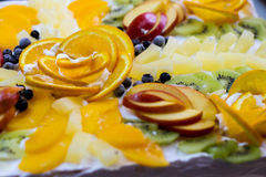 Fruit pieces on cream. Stock Image