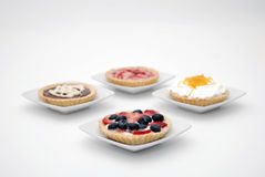 Fruit pies. Individual cream cakes and fruit on white background Royalty Free Stock Photography