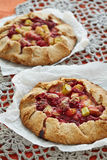Fruit pies on a knitted tablecloth Stock Photo