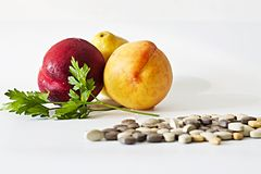 Fruit or pills? Stock Photo