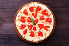 Fruit pizza, delicious strawberry pastry royalty free stock images