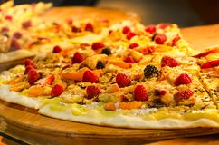 Fruit pizza with fresh forest berries and fruit slices Royalty Free Stock Image