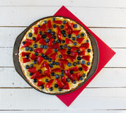 Fruit Pizza on Red and White Background Stock Images