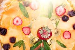 Fruit pizza with strawberries kiwi pineapple Stock Photo
