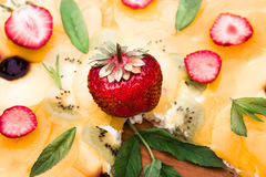 Fruit pizza with strawberries kiwi pineapple Stock Images