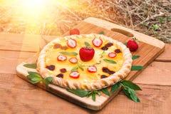 Fruit pizza with strawberries kiwi pineapple Royalty Free Stock Photos