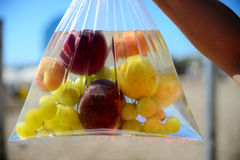 Fruit in plastic bag with water. In Barcelona Stock Image