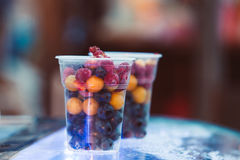 Fruit in a plastic cup. Street trading. Street food. royalty free stock photography