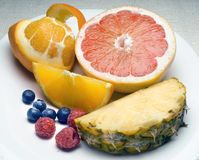 Fruit plate. With sliced items Royalty Free Stock Images