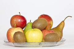 Fruit Plate. Some Fruits, with a Kiwi in front, in a plate stock images