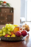 Fruit plate. Interior of a modern kitchen and fruit plate on the table royalty free stock image