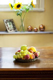 Fruit plate. Interior of a modern home and fruit plate on the table royalty free stock image