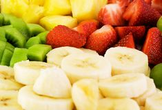 Fruit Plate. With bananas,strawberries,kiwis and pineapples Stock Image