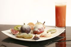 Fruit plate and carrot juice Royalty Free Stock Photos