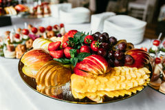 Fruit plate with different fruits on table Stock Photo