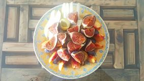 A Fruit Plate with Fig, Peaches. On a wooden table royalty free stock image