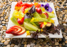 Fruit Plate with Flowers Royalty Free Stock Photos