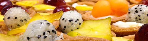 Fruit Plate. Fresh Fruit plate with pastries Stock Images