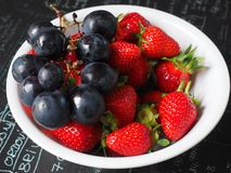 Fruit Plate, Grapes, Strawberries Stock Images